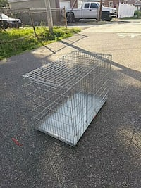 (1)Silver metal folding dog crate (3) Black Cages. Eddystone, 19022
