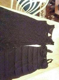 two women's black lace and layered tank mini dresses