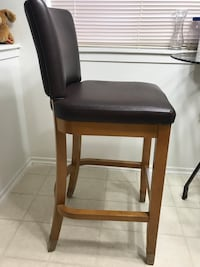 Brown wooden frame brown leather padded bar stool or chair Montgomery Village