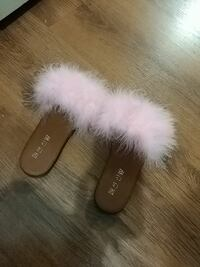 pair of brown-and-white fur slide sandals