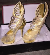 pair of gold-colored open-toe heeled sandals Calgary, T3K 3V8