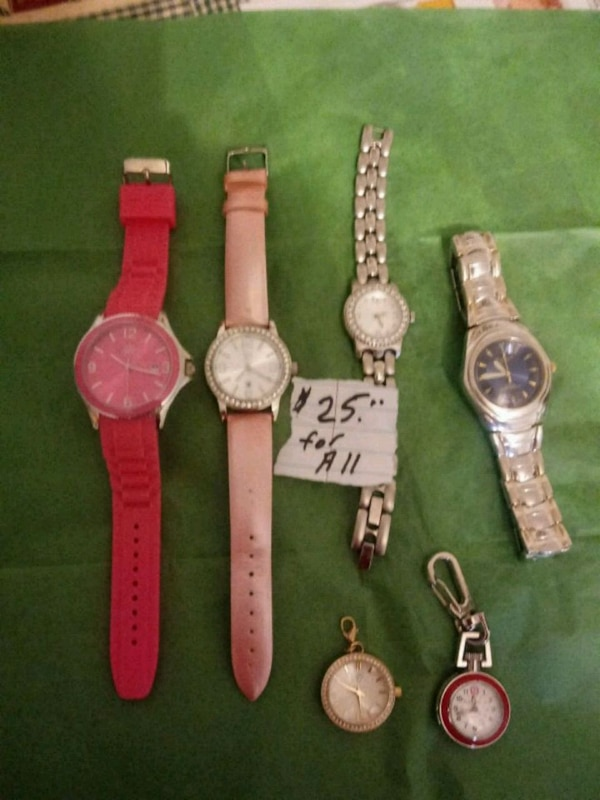 six assorted-color analog watches