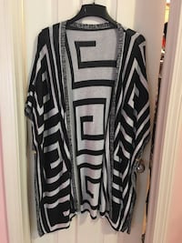 New Without Tags size M/L sweater. Located in Jefferson