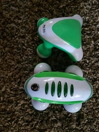 green and white plastic toy