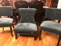 two brown wooden framed gray padded armchairs Montréal, H1L 2N7
