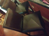 two padded black leather armless chairs Denver, 80204