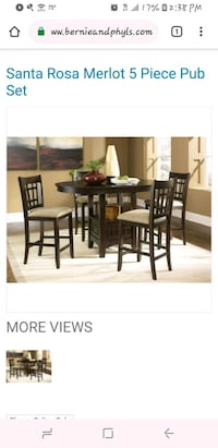 Oval  brown wooden table with six chairs din New Bedford, 02746