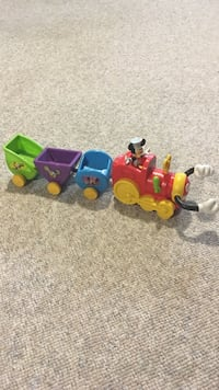 red, blue, and green Mickey Mouse train toy 13 km