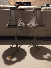 Two stainless steel base table lamps
