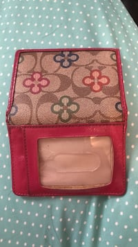 pink and brown leather Coach floral bi-fold wallet Evansville, 47712