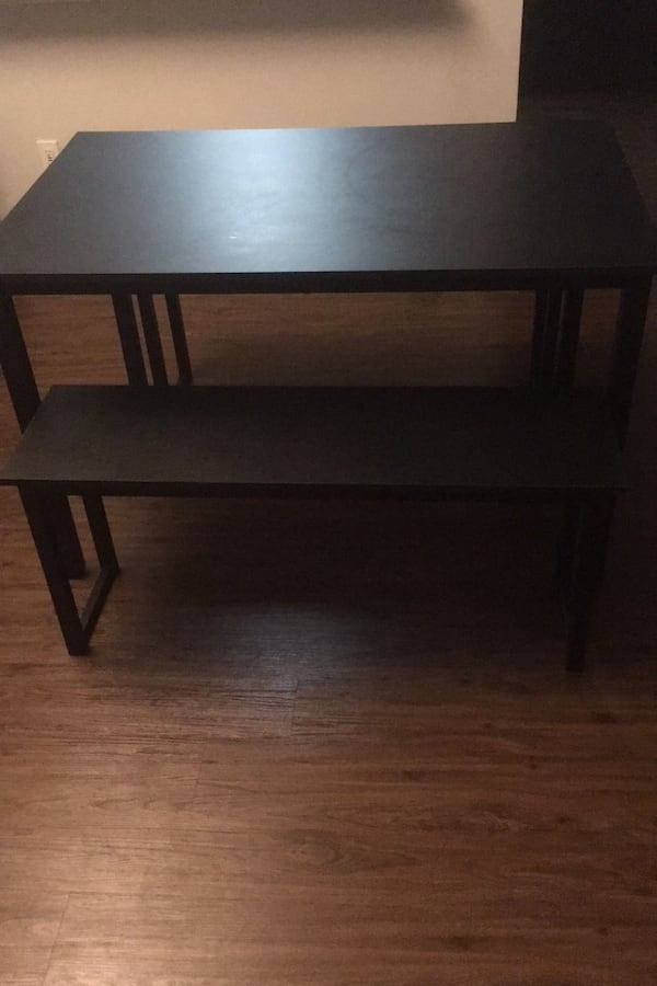 Black Table with 2 benches 54c8886d-31dc-499b-ae2b-cd93dadb579e