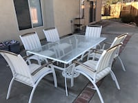 Rectangular glass top table with six chairs