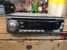 Silver and black JVC single din head unit