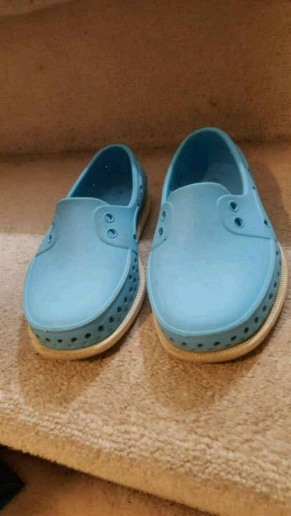 pair of blue slip-on shoes