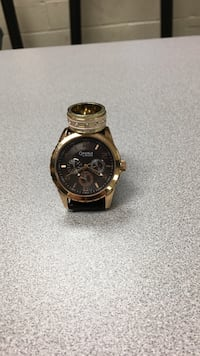 round black chronograph watch with brown leather strap 865 mi