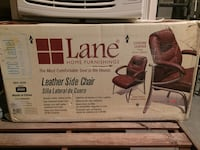 Brand new never opened leather side chair  187 mi