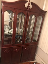 Cherry wood china closet in excellent condition New York, 11385