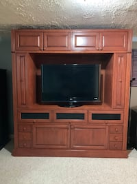 flat screen television with brown wooden TV hutch Woodbridge, 22192