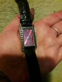 square silver analog watch with black leather strap Saint Catharines