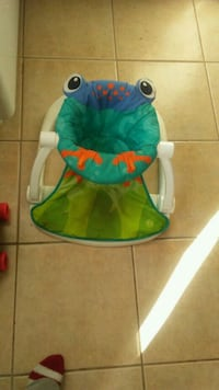 baby's blue Fisher-Price frog bouncer