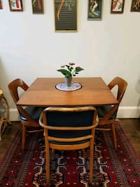 Beautiful vintage drop leaf table with rolling metal claw legs