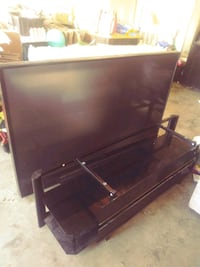 black flat screen TV with remote Moreno Valley, 92555