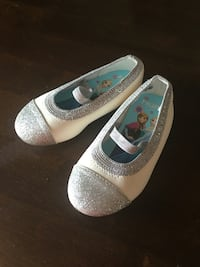 White and silver slip on shoes Size 6.5 Olathe, 66062