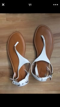 pair of brown-and-white leather sandals 50 km