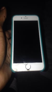 silver iPhone 6 with teal case