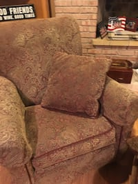 brown floral sofa chair with ottoman