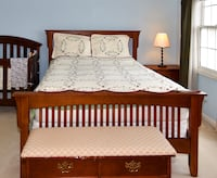 Solid wood bed size queen - headboard, footboard and box spring- great deal! Rockville, 20854