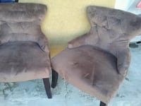 two gray suede sofa chairs