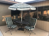 SOLID WROUGHT IRON TABLE WITH 4-ROCKER CHAIRS WITH CUSHIONS AND UMBRELLA WITH SOLID HEAVY METAL UMBRELLA STAND  Yuma, 85365