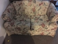beige, red, and green floral 2-seat sofa