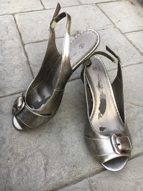 pair of gray leather open-toe heeled sandals