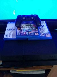 black Sony PS4 console with controller and game cases Omaha, 68144