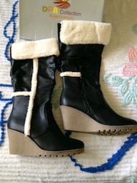 pair of black-and-white boots Kitchener