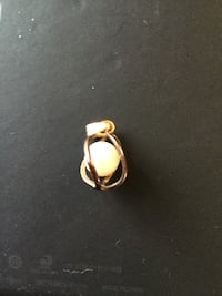 gold-colored with pearl pendant