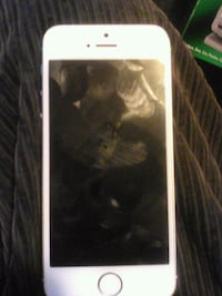 gold iPhone 6 with black case 2370 mi