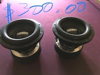 two black-and-gray Sundown coaxial speakers