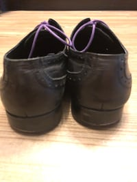 Pair of black leather dress shoes Vienna, 22031