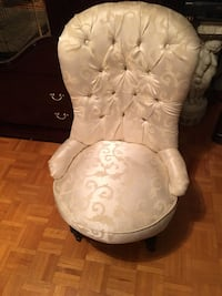 Antique off white chair on wheels. Excellent condition.