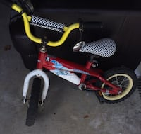 toddler's yellow and black bicycle Whitby, L1N 9T9
