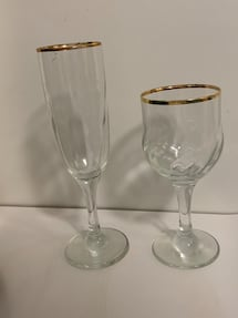 Wine and champagne glasses with gold trim. Set of 12 for each.