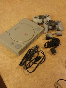 Playstation console with controllers