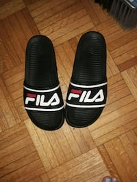 pair of black-and-white fila slide sandals Toronto, M1G 1H5