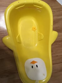baby's yellow plastic bather London, N5W 4A4