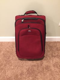 red and black luggage