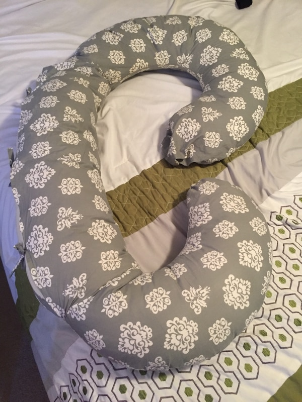 Super comfy body pillow with gray pillow case