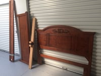 Brown wooden bed headboard and footboard Winchester, 22601